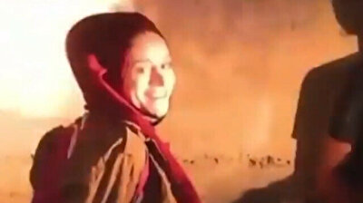 Palestinian woman 'all smiles' while being handcuffed by Israeli troops
