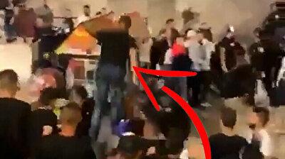 Palestinian youth fly kicks Israeli police during Al-Aqsa Mosque raid