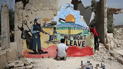 Syrian artist expresses solidarity with Palestinians in Al-Aqsa Mosque graffiti