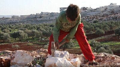 Syrian children earn living by working in stone quarry