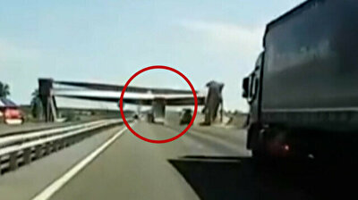 Raised dump truck bed destroys overpass in Russia