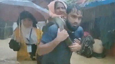 Rohingya Muslims submerged in water after raging monsoons hit camp