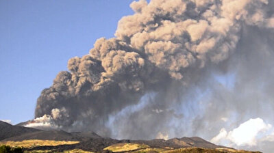 Clouds of black smoke rise from erupting Mount Etna