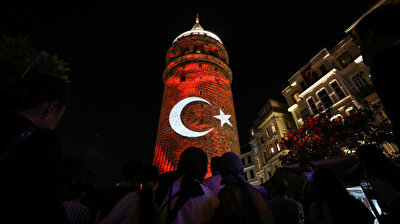 Istanbul's Galata Tower shimmers with colors of Turkish flag on Victory Day