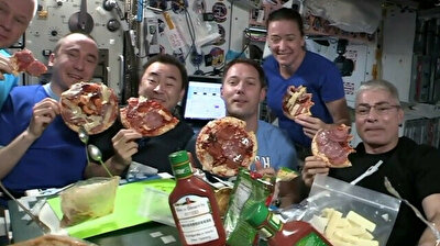 Party time! Astronauts enjoy 'floating pizza' feast in space