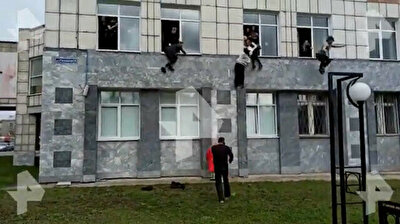 Terrifying footage shows students jumping from windows to escape gunman at Russian university