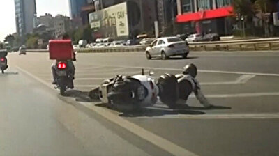 Risky highway stunt with two motorcycles driving in tow ends badly