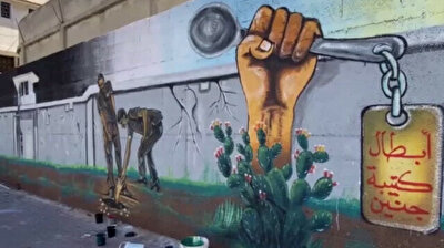 Gazan artists paint murals in honor of escaped Palestinian prisoners