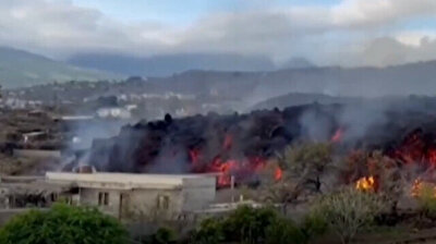 Molten lava fills swimming pool as volcano erupts on Canary Island