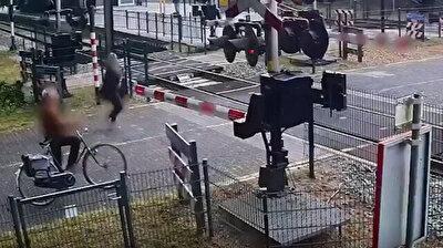 Irresponsible woman walking on train tracks narrowly avoids certain death in Netherlands