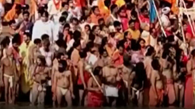 Thousands of Hindus take holy dip in Ganges River to celebrate festival in India