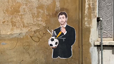 Mural shows Juventus chairman stabbing soccer ball with knife