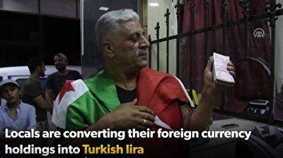 Al-Bab locals exchange cash into lira to support Turkey