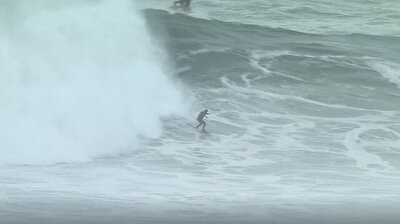 Surfers stick around after event to ride the huge waves of Nazare
