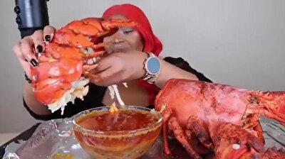 Red-haired girl eats monster lobster