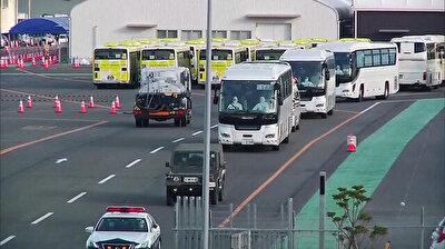 Passengers disembark from virus-hit Diamond Princess in Japan after quarantine