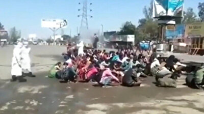 India sparks outrage after 'spraying migrants' with disinfectant to fight coronavirus