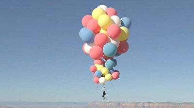 Daredevil David Blaine performed his latest stunt on Wednesday, ascending nearly 25,000 feet (7,600 meters) into the Arizona sky while hanging from a cluster of jumbo-sized balloons before parachuting safely back to earth.