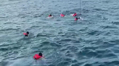 Desperate migrants jump overboard from charity boat off Italy