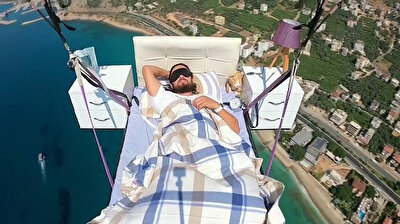 A 29-year-old Turkish professional paraglider, who previously soared through the sky while calmly sitting on a red leather sofa watching TV, performed his latest stunt on Wednesday, taking a nap in an open-air bed over the sea off the coast of Alanya. The video of Hasan Kaval's stunt has quickly gained thousands of likes.