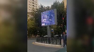 Azerbaijan broadcasts footage of drones striking targets across Baku public squares