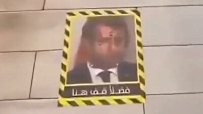 Kuwaiti restaurant decorates floors with Macron photo for clients to step on