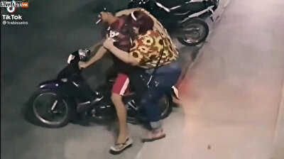 Overweight woman tips motorcyle over