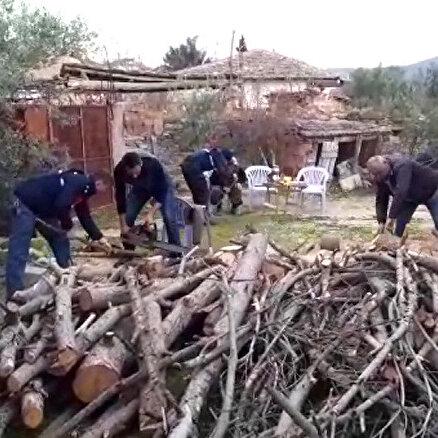 Şehit annesinin odunlarını kestiler