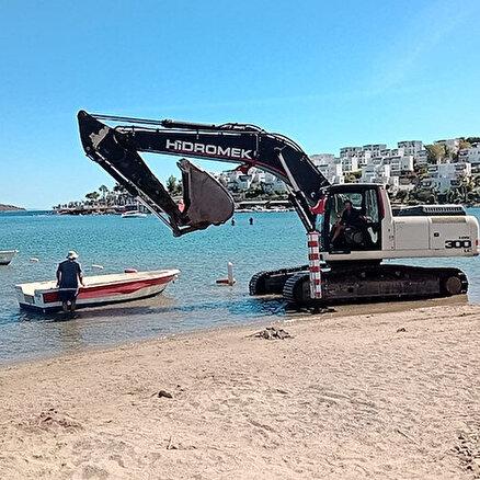 İş makinesiyle denize daldı