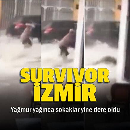 İzmirde yağmur sularına kapılan kadın son anda kurtarıldı