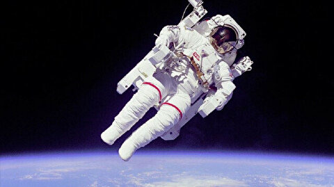 Three astronauts return safely from space