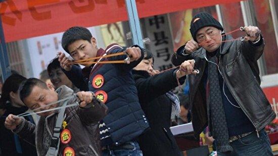 Her şeyi olduğu gibi sapan kullanmayı da abartan Çinliler