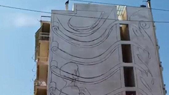 Koskoca binayı birkaç günde sanat eserine çevirmek