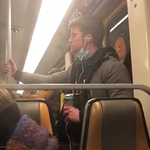 Belçika'da koronavirüslü olduğu iddia edilen bir genç elini ağzına götürüp metro direğine sürdü