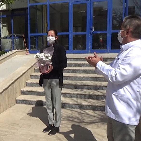 Koronavirüsü yenen sağlık personeli alkışlarla göreve başladı