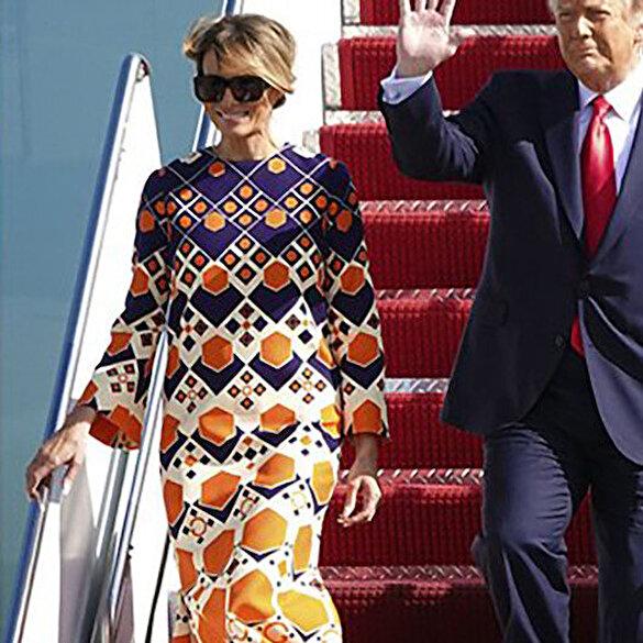 Trump çifti Florida'ya indi: Melania Trump'ın turuncu elbisesi dikkat çekti