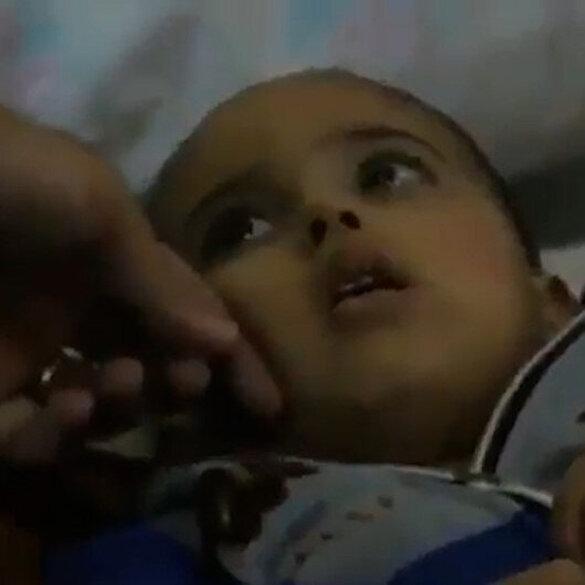 İsrail bombardımanı sonrası şok içerisindeki bir çocuğun görüntüsü izleyenleri derinden etkiledi