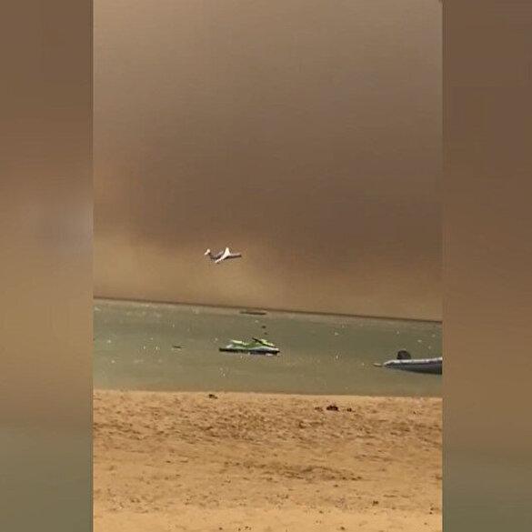 Manavgat'taki orman yangınına havadan müdahale edildiği anlar kamerada