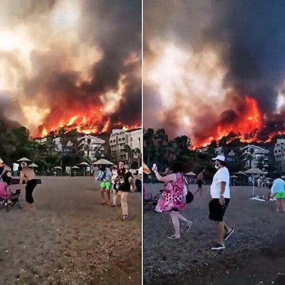 Marmaris'te tatilciler alevlerin yaklaşmasıyla sahili apar topar boşalttı