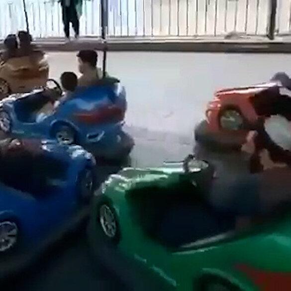 Taliban üyeleri luna parkta çarpışan araba ve atlı karıncaya binerken görüntülendi