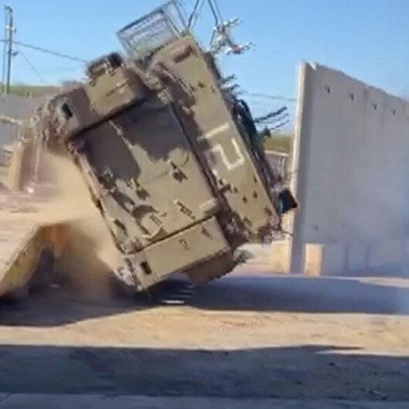 خودروی زرهی ارتش اسرائیل در حالی که روی حامل بارگیری شده بود واژگون شد