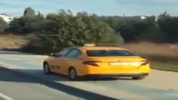 Despicable taxi driver cruising on pavement h...