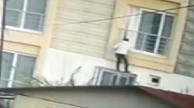 Thief hurtles himself out of window when conf...