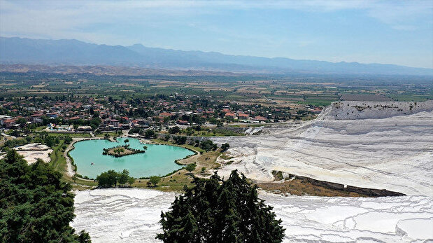 Visit mesmerizing ancient town of Hierapolis in Turkey, take a swim in the travertines