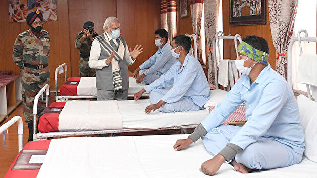 India's Modi meets soldiers wounded in fights...