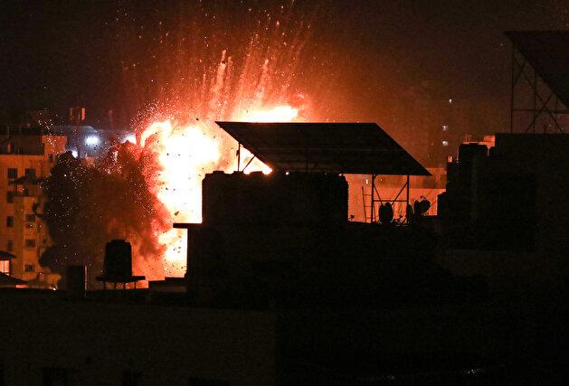 Israeli warplanes hit buildings in Gaza Strip