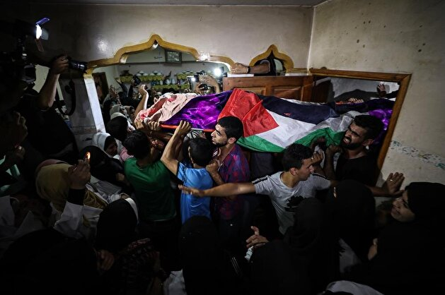 Palestinians attend funeral of fallen paramedic killed by Israeli snipers