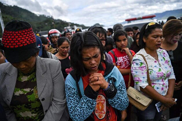 Relatives of missing passengers of the sank ferry in Lake Toba