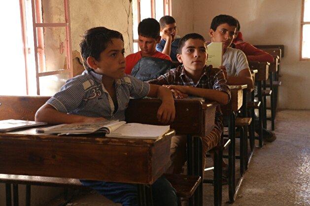 Despite Assad bombings, defiant children, teachers continue education