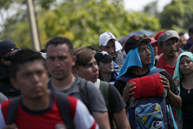 Migrant caravan traveling to US walks by road that links Ciudad Hidalgo with Tapachula